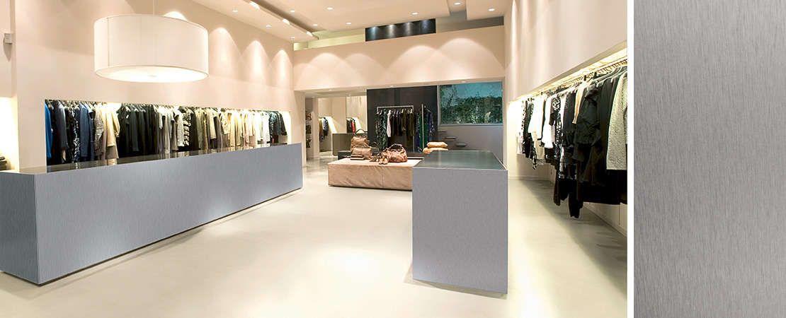 negozio di vestiti arredato con lastre in alluminio Dekodur Starline